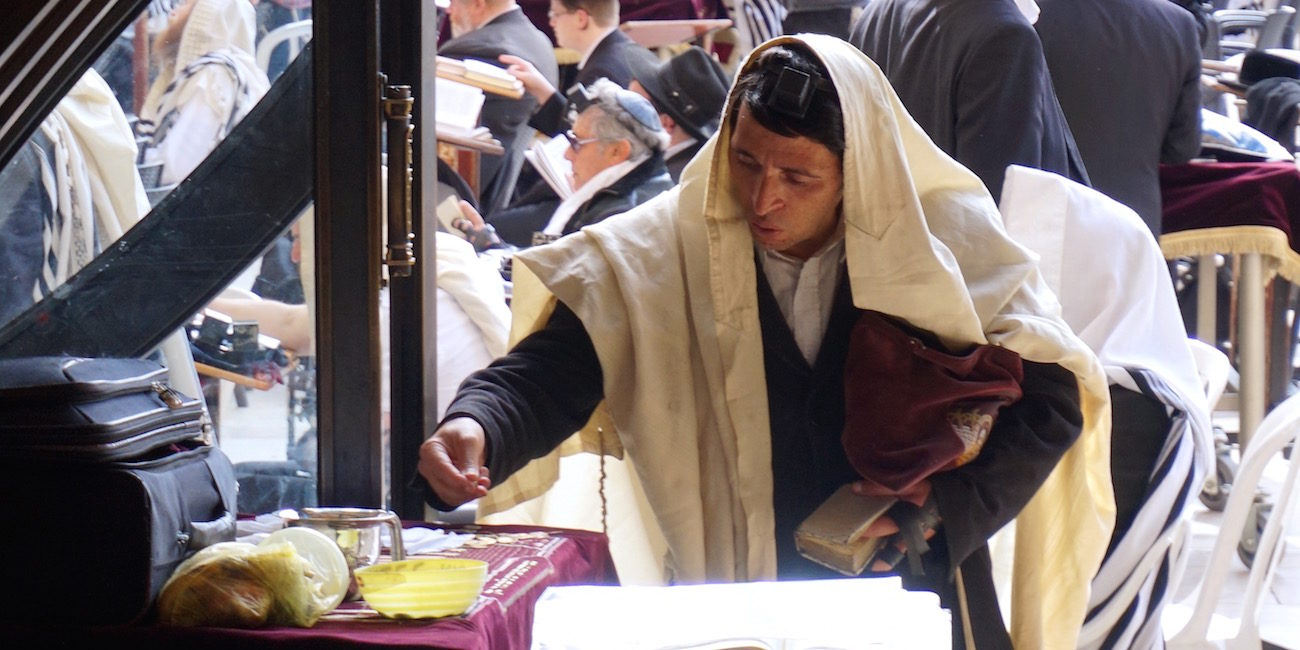 Man Paying Charity Alms Western Wall Jerusalem Israel