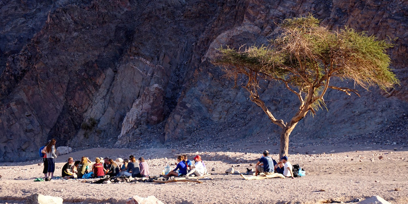 Students Sitting In Desert, Israel